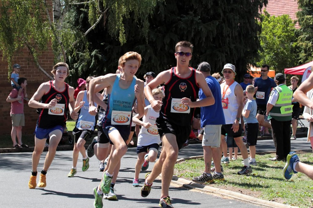 POUNDING THE PAVEMENT: The field gets moving in the Orange Running Festival's 2014 five kilometre.