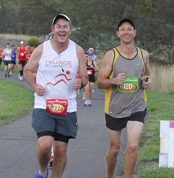 HAPPY FEET: Stewart Vidler (left, with Terry Baker during the 2014 Colour City Running Festival) was in the winning relay team with Anna Daintith.