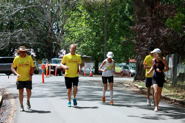 EXTRA SUPPORT: The Orange Colour City Running Festival's last marathon runner Pam Davy (centre) is encouraged home over the final 500 metres by John Betts (assistant coordinator), John Bowmer (marshalling team leader), David Gibson (OCCRF coordinator) and Kinisha Roweth (ORC publicity).
