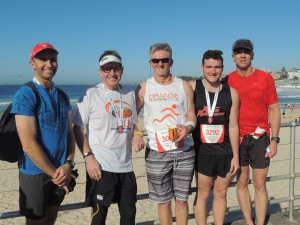 SURF'S UP : Orange Runners Club members from left Mitch Essex, Frank Ostini, Mike cooper, Kyle Ostini and Tony Syme finished the 2015 C2S